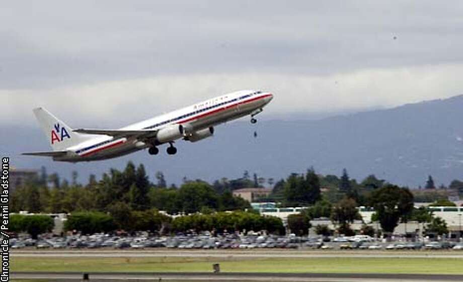 An American Airlines plane takes off at San Jose Int'l Airport. CHRONICLE PHOTO BY PENNI GLADSTONE Photo: Penni Gladstone
