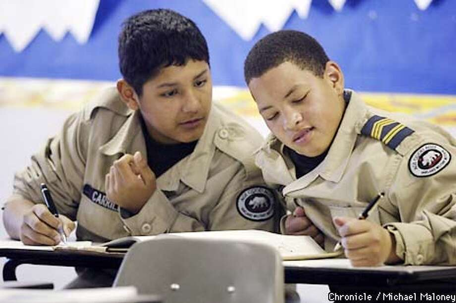 Cadets Christian Carrillo (left) and Edwin Peabody work on a math problem together.  Oakland Military Institute (OMI) is Jerry Brown's military charter school now at the half-way point of it's first year. Only a handful of children have dropped out, but on the flip-side one-third who stayed earned D averages on their first report card. CHRONICLE PHOTO BY MICHAEL MALONEY Photo: MICHAEL MALONEY