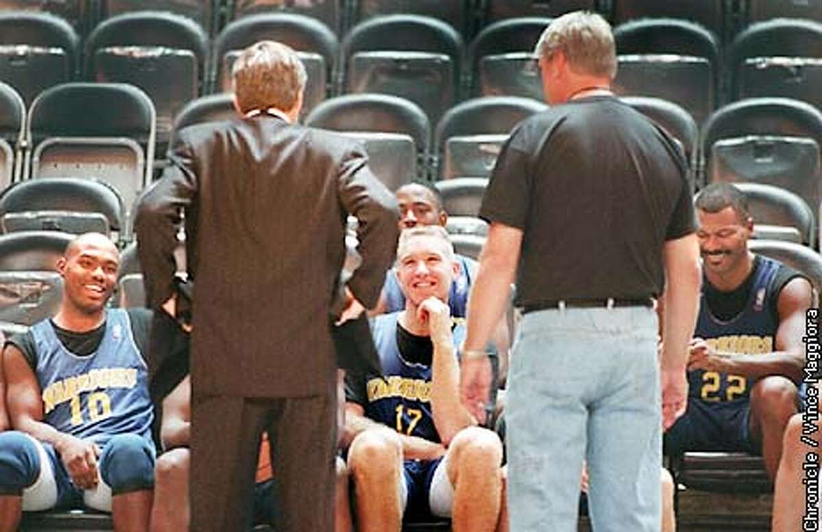 When new owner Chris Cohan chatted up Tim Hardaway (10) and Chris Mullin (17) in 1994, the team was coming off its last winning season. Chronicle photo by Vince Maggiora