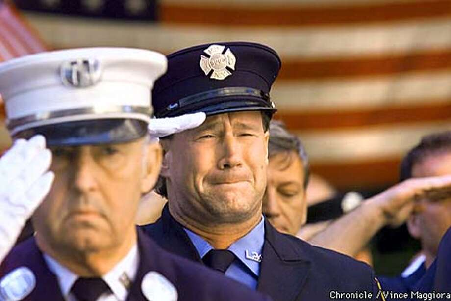 NY Firefighter Papillo(nothing more), cries at the Mass of christian burial at the church of Saint Francis Of Assisi for Fr.Mychal F. Judge the chaplian for FDNY was killed at the world trade center.Days after the terrorist attack on the World Trade Center in New York  BY Vince Maggiora Photo: VINCE MAGGIORA
