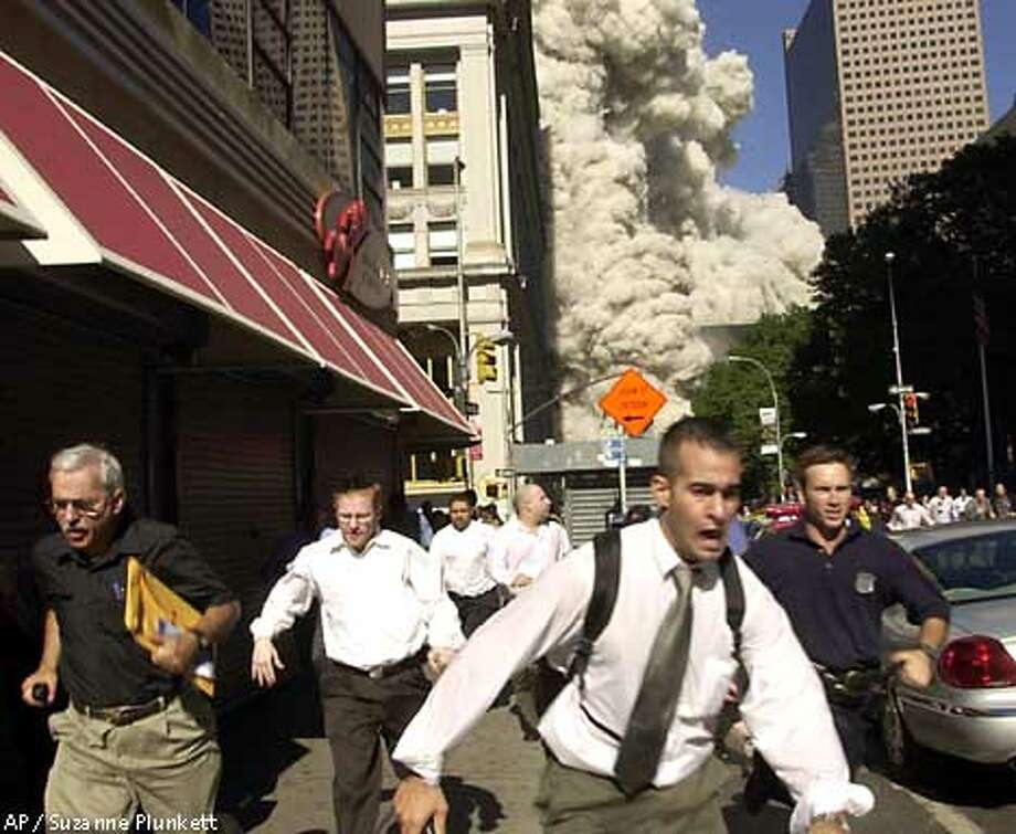 People run from the collapse of World Trade Center Tower Tuesday, Sept. 11, 2001 in New York. (AP Photo/Suzanne Plunkett) Photo: SUZANNE PLUNKETT