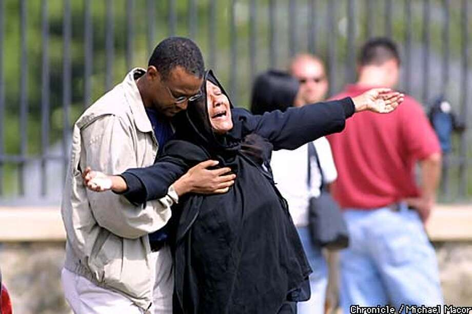A woman is overcome with emotion after visiting the Pentagon Building crash site. by Michael Macor/The Chronicle Photo: MICHAEL MACOR