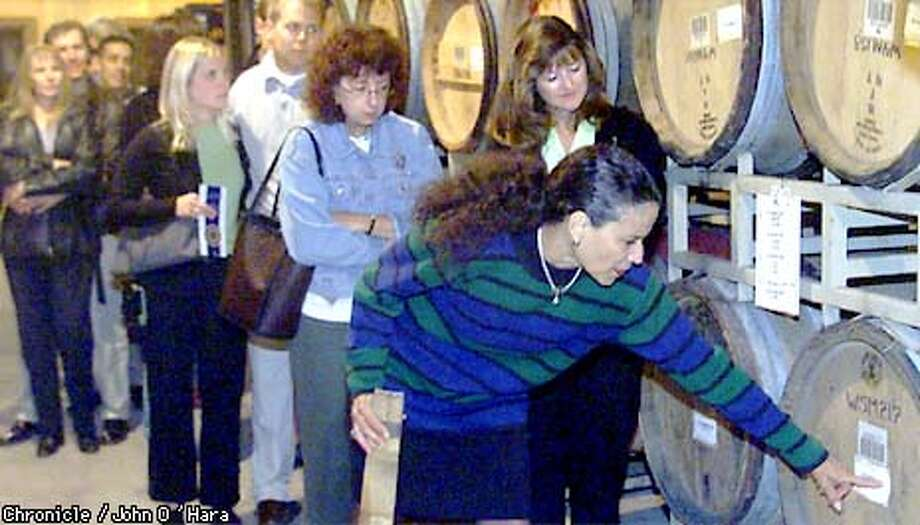 "Merryvale Winery 1000 Main st. St. Helena,CA  ""SANDRA BARROS"", Wine Educator and retail sales, gives a tour/seminar every Sunday. In the storage area, Sandra talks about how a barrel is constructed, and how long it lasts.  Photo/John O'Hara Photo: John O'Hara"
