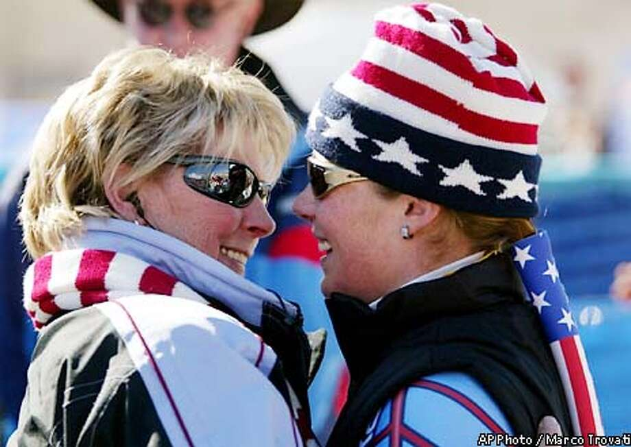 Picabo Street, right, embraces her mother Dee after the the women's downhill in Snowbasin, Utah Tuesday, Feb. 12, 2002 at the Salt Lake City Olympics. Street finished 16th. (AP Photo/Marco Trovati) Photo: MARCO TROVATI