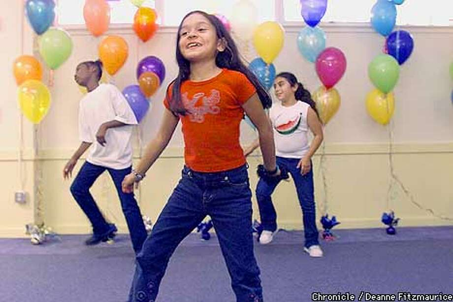 During a grand opening( l to r) Jamilla Cato, Diana Hazas (front), and Catalina Ortega practice a dance they learned in the TNDC after- school program in the Tenderloin.  CHRONICLE PHOTO BY DEANNE FITZMAURICE Photo: DEANNE FITZMAURICE