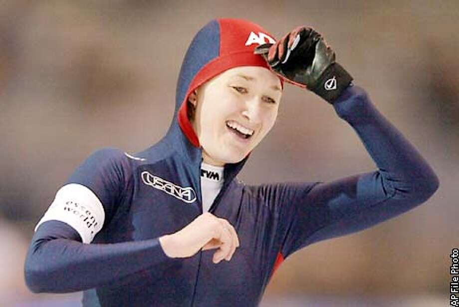 United States' Jennifer Rodriguez smiles as she finishes the women's 1000 meter Saturday, Dec. 1, 2001, at the sprint competition at the Utah Olympic Oval in Kearns, Utah. Rodriguez won the event. (AP Photo/Elaine Thompson) Photo: ELAINE THOMPSON
