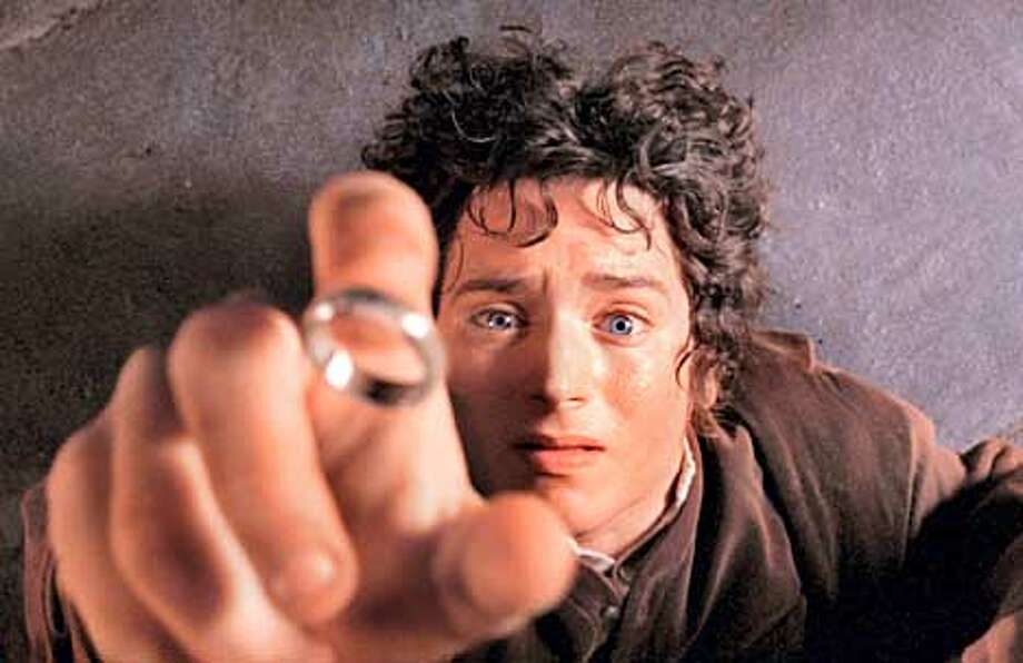 "Actor Elijah Wood appears as the Hobbit Frodo in a scene from ""The Lord of The Rings: The Fellowship of the Ring,"" in this undated promotional photo. The film received 13 nominations, including best picture, best director and best supporting actor, for the 74th annual Academy Awards which were announced in Beverly Hills, Calif., Tuesday Feb. 12, 2002. (AP Photo/Pierre Vinet, New Line Cinema) Photo: PIERRE VINET"