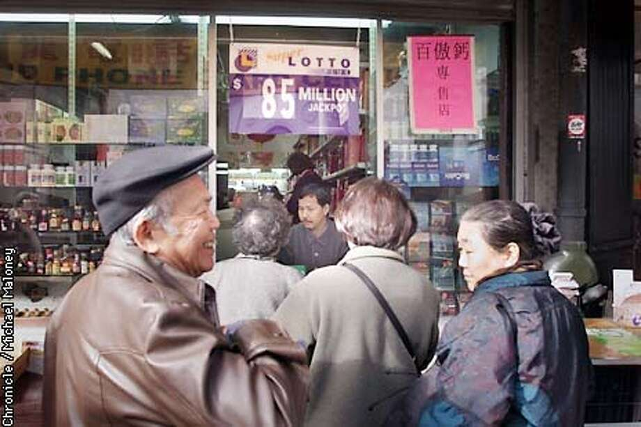 Chung Yau Cheung (all cq), owner of Gum Wah Lee Liquor store on Stockton Street had a busy morning at the walk-up Lotto window of his Chinatown store. He said there has been a steady stream of ticket buyers due to the $85 million Lotto. (Cheung is the guy in the window)  CHRONICLE PHOTO BY MICHAEL MALONEY Photo: MICHAEL MALONEY