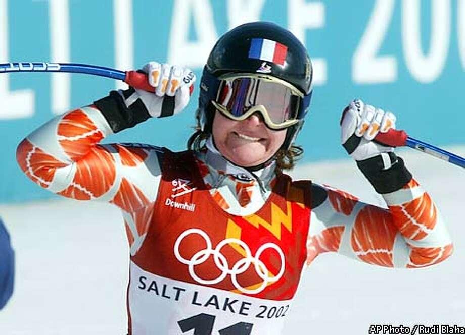 Carole Montillet of France celebrates as she wins the gold medal in the Salt Lake City Winter Olympic Games Women's Downhill in Snowbasin, Utah Tuesday Feb. 12, 2002. (AP Photo/Rudi Blaha) Photo: RUDI BLAHA