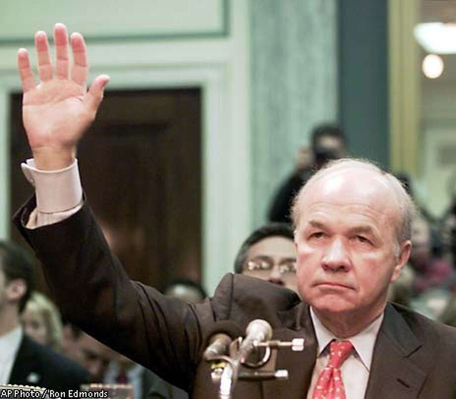 Former Enron CEO Kenneth Lay is sworn in at a Senate Commerce Committee hearing on Capitol Hill Tuesday, Feb. 12, 2002, in Washington. Lay took the Fifth Amendment and refused to testify to the committee.. (AP Photo/Ron Edmonds) Photo: RON EDMONDS