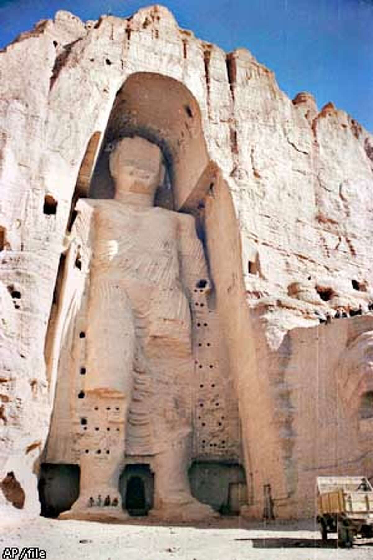 The 53-meter (175-foot) tall, 2000-year-old Buddha statue located in Bamyan, about 150 kilometers (90 miles) west of the Afghan capital Kabul, is shown in this undated photo. Afghanistan's hardline Taliban rulers ordered the destruction, Monday, Feb. 26, 2001 of all statues as insulting Islam, including this world's tallest standing Buddha statue which was already damaged in fightings. (AP Photo) ALSO RAN: 03/09/2001