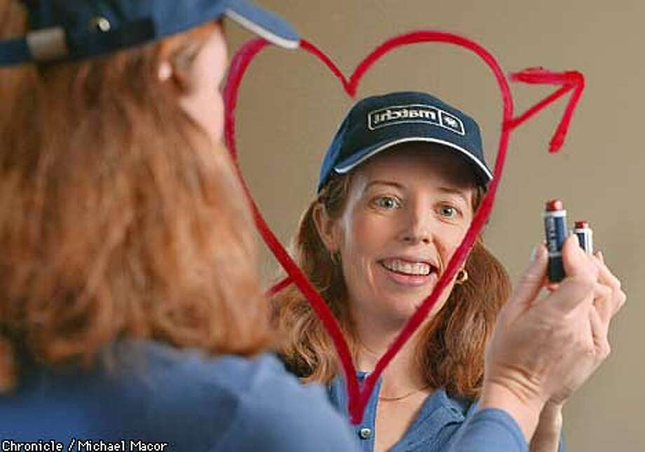 "Trish McDermott seen through a lipstick drawn heart on a mirror. Profile of Trish McDermott has the enviable title Vice President of Romance at ""Match.com"", a dating sevice, she talks about her 15 yerars in the dating industry. by Michael Macor/ The Chronicle Photo: MICHAEL MACOR"