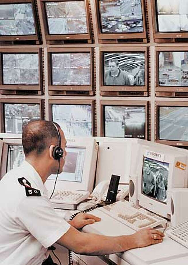 A technician monitored video surveillance technology made by Visionics Corp.