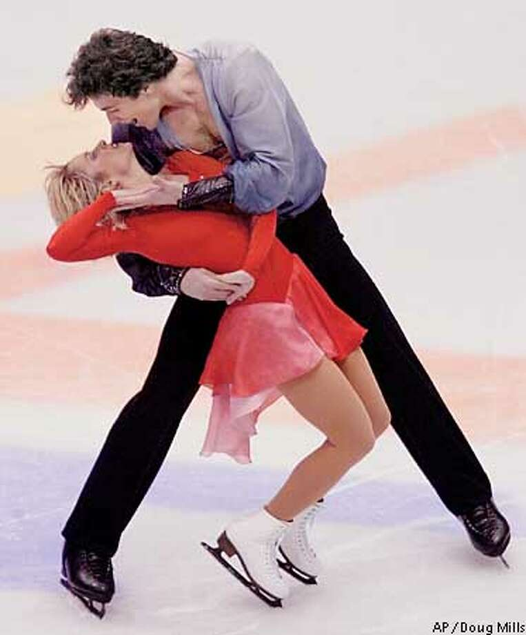 Russian figure skaters Elena Berezhnaya and Anton Sikharulidze compete in the pairs free program in the Winter Olympics at the Salt Lake Ice Center in Salt Lake City, Monday, Feb. 11, 2002. (AP Photo/Doug Mills) Photo: DOUG MILLS