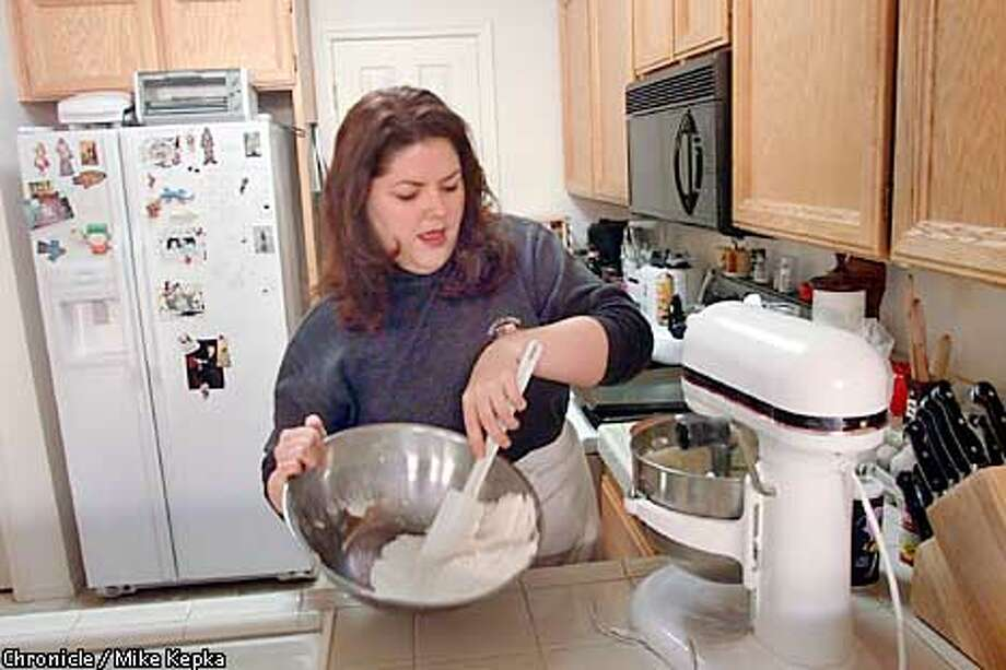 Meghan McCloskey works on a the perfect poundcake in her Pleasanton kitchen. BY MIKE KEPKA/THE CHRONICLE Photo: MIKE KEPKA