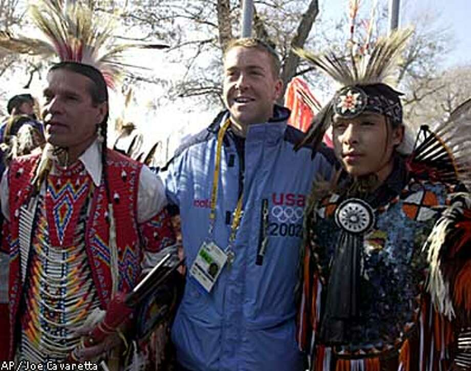 Skeleton slider Jim Shea (center) hung out with Evan Grant (right) and Rick Grant, Native American dancers who performed yesterday. Associated Press by Joe Cavaretta