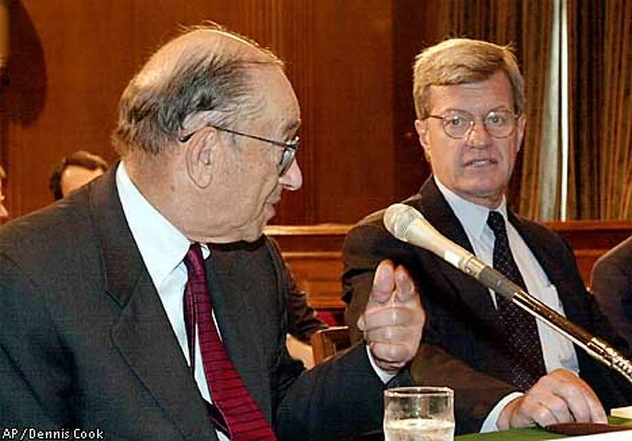 Senate Finance Committee Chairman Max Baucus, D-Mont., right, meets with Federal Reserve Board Chairman Alan Greenspan on Capitol Hill Tuesday, Sept. 25, 2001, to discuss the nation's economy in the wake of terrorist attacks Sept. 11. (AP Photo/Dennis Cook) Photo: DENNIS COOK