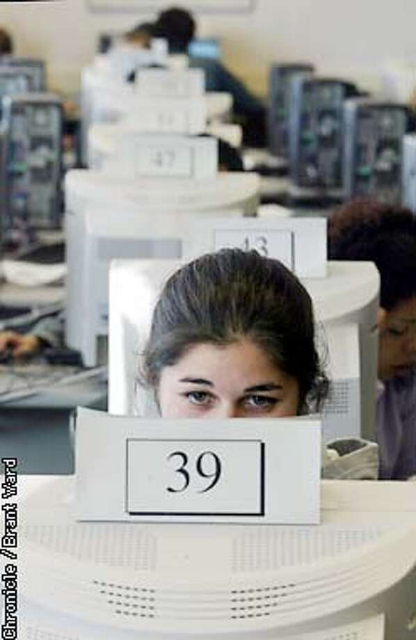 At San Francisco State University, there are almost always waiting lines to use the computers...here Francisca Fuentes, an exchange student, uses number 39 to surf the net for research. By Brant Ward/Chronicle Photo: BRANT WARD