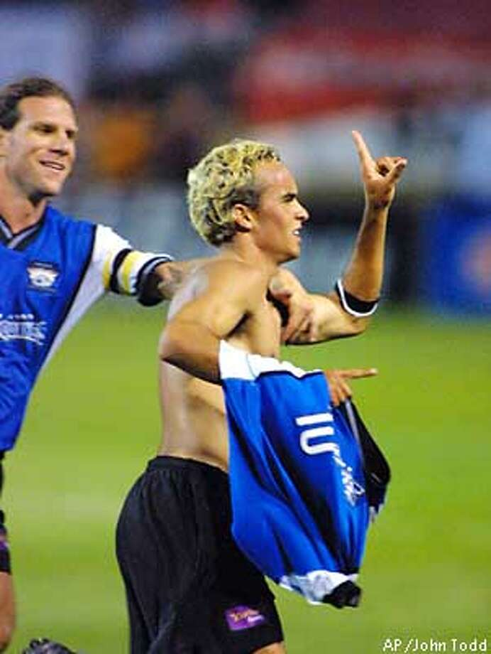 San Jose Earthquakes' Landon Donovan, right, celebrates with Jeff Agoos, left, after scoring against the Columbus Crew in the second half at Spartan Stadium in San Jose, Calif., Wednesday, Sept. 26, 2001. (AP Photo/John Todd) Photo: JOHN TODD