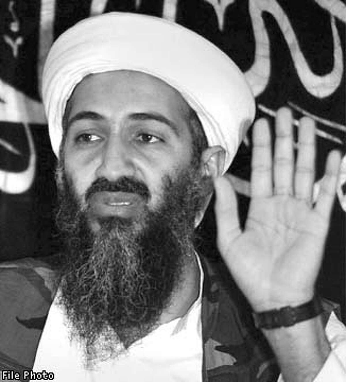 Saudi-exile Osama bin-Laden is seen addressing a news conference in Afghanistan, where he and his organization are based, in this May 26, 1998 file photo. The U.S. on Thursday started to gear up for what it called the first war of the 21st century, naming bin Laden as a suspect in twin terror attacks that stunned New York and Washington. The leader of Afghanistan's ruling Taliban movement on Friday defended bin Laden against accusations he mastermind the devastating attacks. REUTERS/Str/File photo