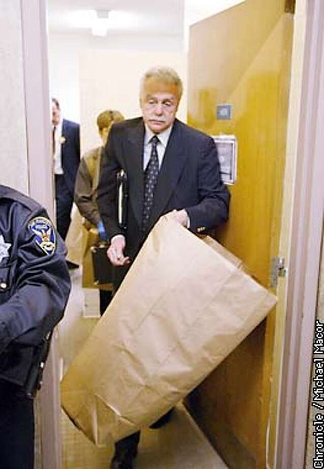 Inspector Bob Huegly carries a bag full of evidence from the first floor bathroom where an explosive device blew apart a stall inside. SF Hall of Justice Building where the first floor was evacuated after an explosion in a bathroom. by Michael Macor/The Chornicle Photo: MICHAEL MACOR