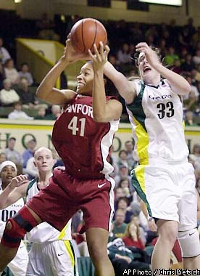 Stanford's Bethany Donaphin (41) brings down a rebound under pressure from Oregon's Cathrine Kraayeveld (33) during the first half at McArthur Court in Eugene, Ore., Thursday, Feb. 7, 2002. (AP Photo/Chris Pietsch) Photo: CHRIS PIETSCH