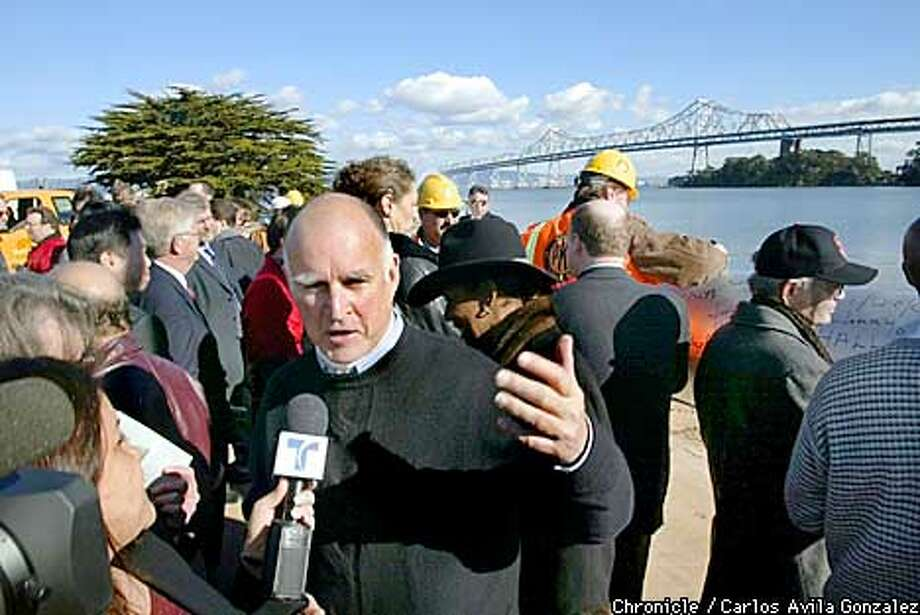 Oakland Mayor Jerry Brown speaks with a local television station following groundbreaking ceremonies for the new portion of the Bay Bridge on Treasure Island on Tuesday, January 29, 2002. (Photo by Carlos Avila Gonzalez/The San Francisco Chronicle) Photo: CARLOS AVILA GONZALEZ