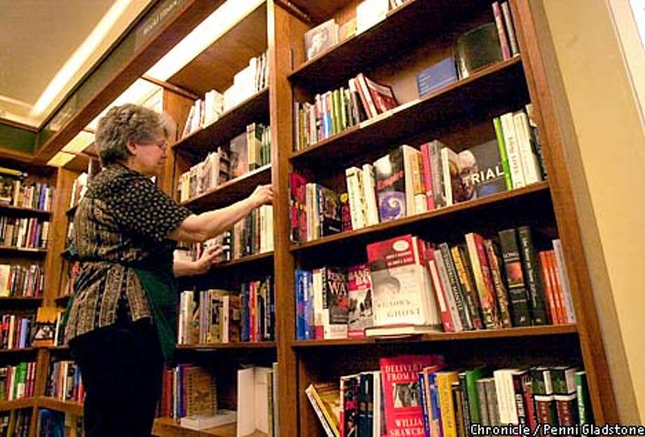 Dorothy Perkins, a bookseller at Stacey's bookstore on Mkt street straighting up a shelf in the morning next to the bookshelf that has been depleted in the mideast section at right. Whereas the other sections are packed tight. Turns out the relevant books are mostly sold out. CHRONICLE PHOTO BY PENNI GLADSTONE Photo: Penni Gladstone