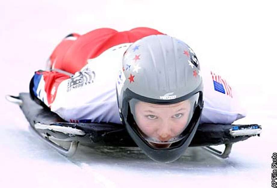 FOR USE WITH OLYMPIC FEATURES PACKAGE--JAN. 26-27--FILE--Tristan Gale starts down the track to a first-place finish on a run in the Olympic skeleton trials at the Utah Olympic Park in this Dec. 28, 2001 file photo, in Park City, Utah. Skeleton, which started in Switzerland, made its Olympic debut in 1924, took 20 years off, and last appeared in the 1948 Winter Games on St. Moritz's famed Cresta Run is coming back in Salt Lake City. (AP Photo/Steve C. Wilson) Photo: STEVE C. WILSON