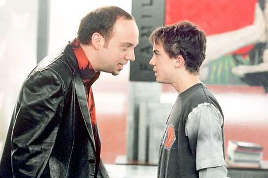 Fourteen-year-old Jason Shepherd (Frankie Muniz) confronts movie producer Marty Wolf (Paul Giamatti) over a stolen idea. Photo: HANDOUT