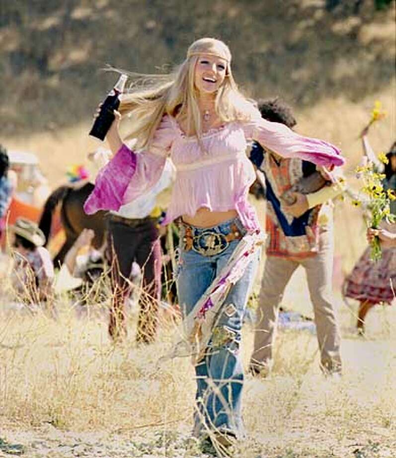 Britney Spears is dressed as a hippie in a 2002 Pepsi commercial to be braodcast during the Super Bowl. Spears reprises Pepsi's jingles dating as far back as the 1950s in the commercials . (AP Photo/HO)