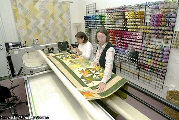 Sally Davey, owner of this store at rt. & Mary Anne Jayhartt at the Quilting machine called a Gammill Longarm. Quilts that take weeks can be sewn in just a few hours with this machine. New Pieces, a quilting store in Albany. CHRONICLE PHOTO BY PENNI GLADSTONE Photo: Penni Gladstone