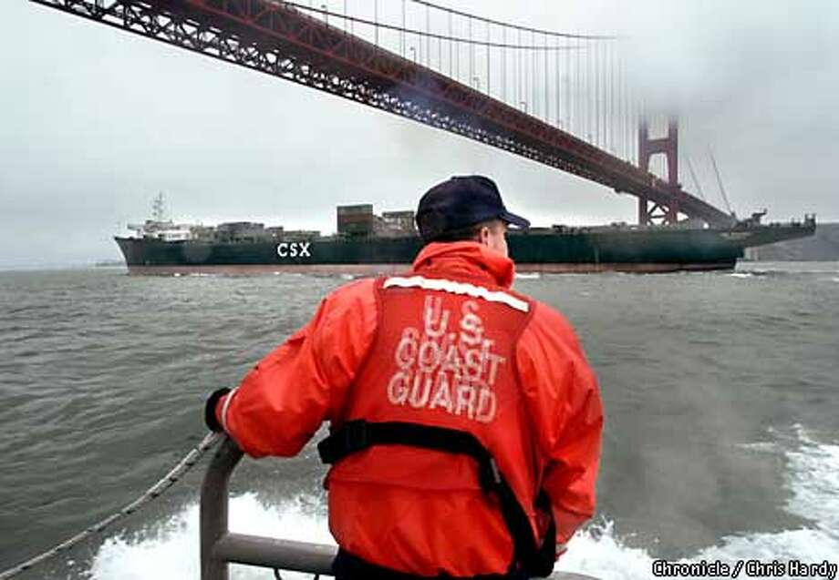 COAST GUARD PATROLLING THE GOLDEN GATE AFTER TERRORIST THREAT  SEAMAN CHRIS RENOIS CHECKING OUT CONTAINER SHIP COMING UNDER THE BRIDGE  -----CHRONICLE PHOTO BY CHRIS HARDY Photo: Chris Hardy