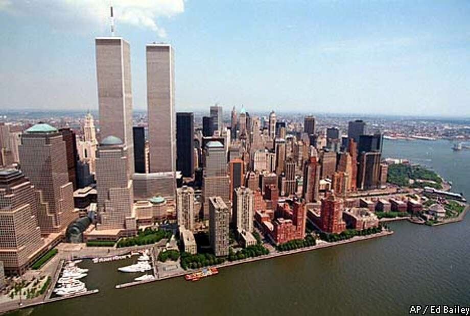 FILE--The twin towers of the World Trade Center rise above the New York skyline in this June 23, 1999 file photo. Both buildings were destroyed on Tuesday, Sept. 11, 2001 after two airliners were hijacked by terrorists and crashed into them. This photo is for use as desired with stories about the terrorist attack. (AP Photo/File, Ed Bailey) Photo: ED BAILEY