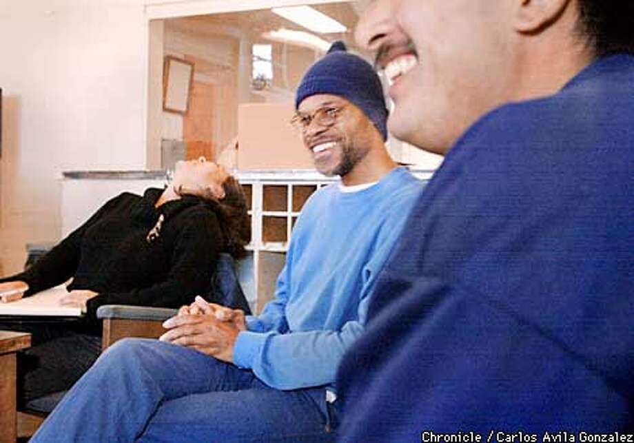 Yolanda Najera, a Peer Health supervisor, left, laughs with Lonnie Morse, an inmate peer health educator at San Quentin Prison on Wednesday, January 16, 2002. San Quentin's education and vocational programs are highly advocated by Warden Jane Woodford, and have been very successful.  (CARLOS AVILA GONZALEZ/SAN FRANCISCO CHRONICLE) Photo: CARLOS AVILA GONZALEZ