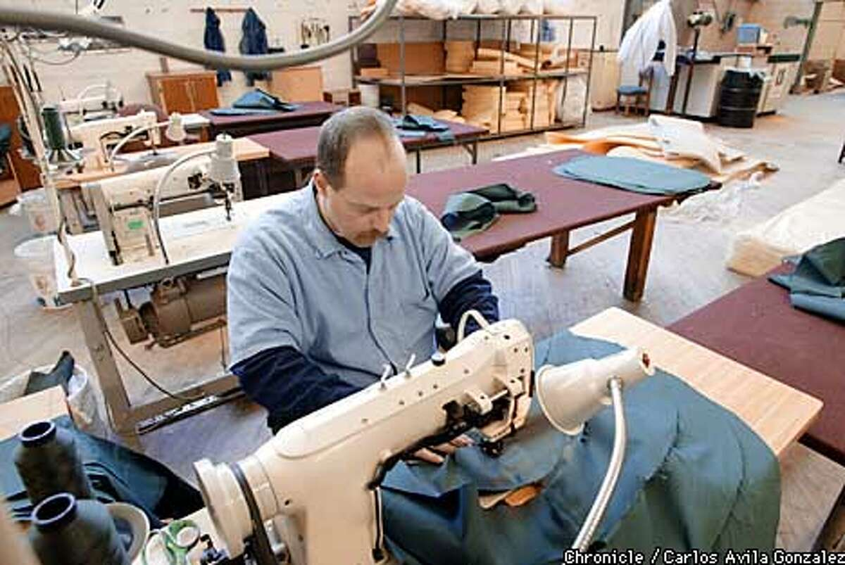 Tim Doyle, an inmate at San Quentin, sews upholstery in the prison's furniture production facility on Wednesday, January 16, 2002. San Quentin's education and vocational programs are highly advocated by Warden Jane Woodford, and have been very successful. (CARLOS AVILA GONZALEZ/SAN FRANCISCO CHRONICLE)