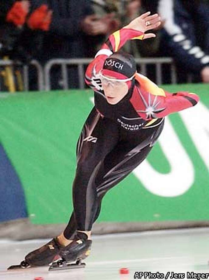 Germany's speed skater Anni Friesinger sprints during the 5,000 meter race at the European Speed Skating Championships in Erfurt, eastern Germany, in this Jan. 6, 2002 photo. Friesinger is the glamour girl of speedskating. By the end of the Winter Olympics, she could be glittering in gold. Friesinger has dominated the World Cup season, emerging as the top Olympic multi-medal contender in her sport. (AP Photo/Jens Meyer) Photo: JENS MEYER