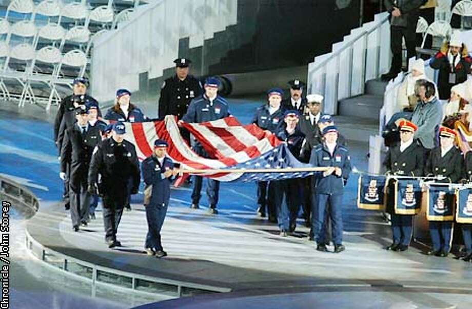 The tattered American flag that flew over the World Trade Center is ushered into the opening ceremonies. The 2002 Winter Olympics opening ceremonies takes place at Rice-Eccles stadium in Salt Lake City, Utah. John Storey/The Chronicle Photo: John Storey