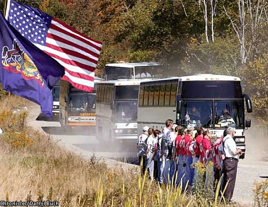 Buses carrying the families of victims of hijacted airliner United Flight 93 return from visiting the crash site along a rural road near Shanksville, PA., as Salvation Army volunteers line up to honor the families as they pass. Chronicle Photo by Darryl Bush Photo: Darryl Bush