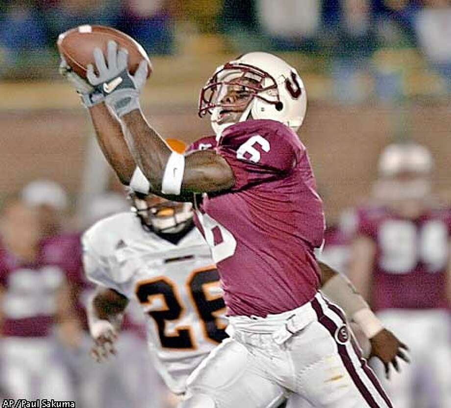Stanford's' Luke Powell catches a pass from quarterback Randy Fasani as he is covered by Arizona State's R.J. Oliver in the first quarter Saturday, Sept. 22, 2001 in Stanford, Calif. (AP Photo/Paul Sakuma) Photo: PAUL SAKUMA