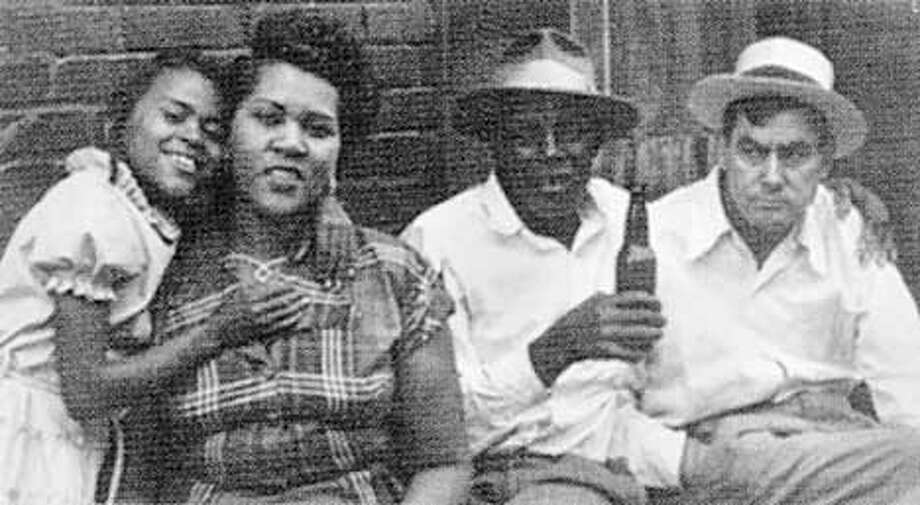 left is Gwen Avery about age 9  her mother Rosa Yarber, and two friends of the family, as they sit outside the speakeasy and relax.