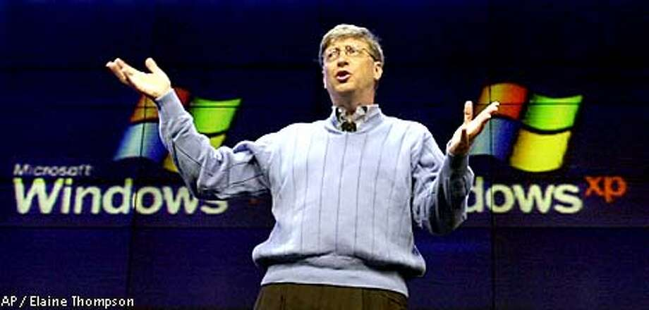 Microsoft chairman and chief software architect Bill Gates addresses members of the media during a news conference unveiling the company's newest operating system, Windows XP, Tuesday, Feb. 13, 2001, in Seattle. Windows XP, built on the enhanced Windows 2000 engine, features a new look and extended personal computing services, including uniting PC's, devices and services. (AP Photo/Elaine Thompson) Photo: ELAINE THOMPSON