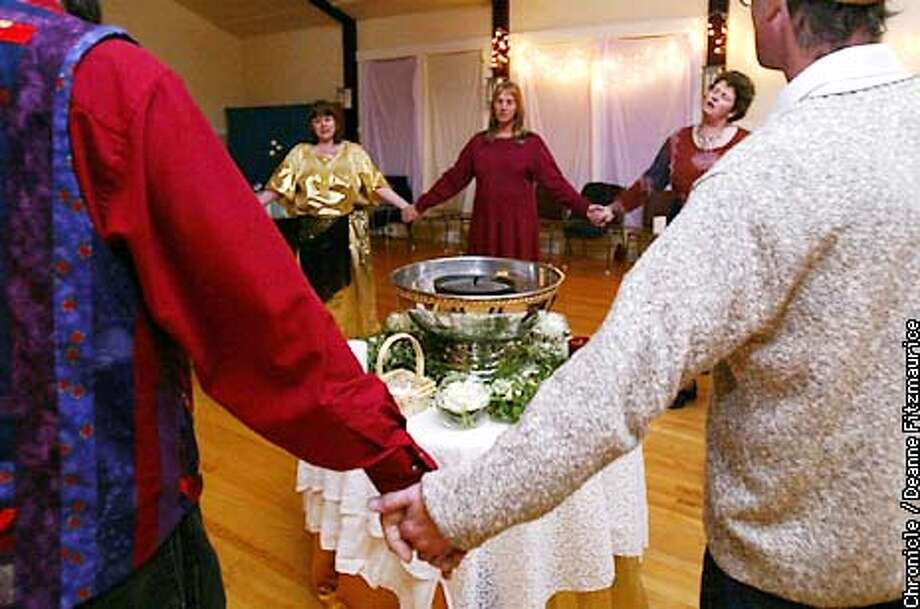 BRIGID1-C-27JAN02-LV-DF  During a run through (before the actual event) participants hold hands and form a circle around their altar to honor Celtic goddess Brigid at Fairfax Community Church.  CHRONICLE PHOTO BY DEANNE FITZMAURICE Photo: DEANNE FITZMAURICE