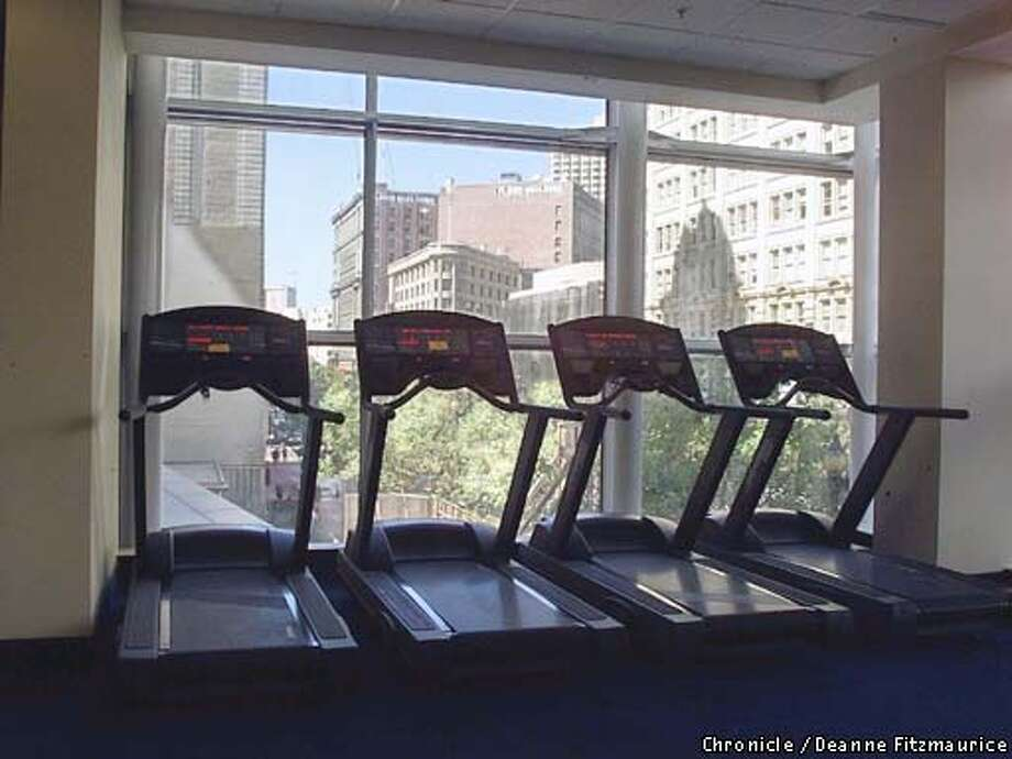 This is the fitness room of the Sports Club at the new Four Seasons Hotel looking out to Market Street in San Francisco.  CHRONICLE PHOTO BY DEANNE FITZMAURICE Photo: DEANNE FITZMAURICE