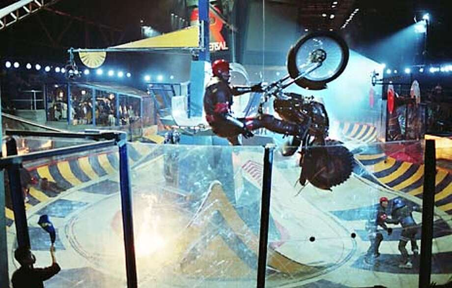 Marcus Ridley (portrayed by LL COOL J) gets airborne in Metro-Goldwyn-Mayer Pictures� action thriller ROLLERBALL. Photo Credit: Attila Dory. HANDOUT.