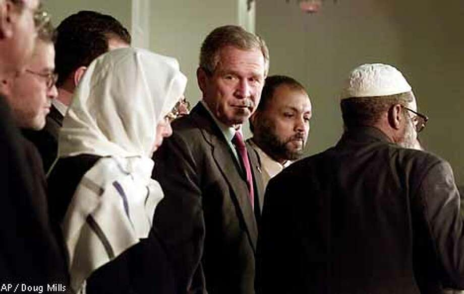 RETRANSMISSION TO CORRECT DATE -- President Bush meets with Muslim religious leaders during his visit to the Islamic Center of Washington, Monday, Sept. 17, 2001, to try to put an end to rising anti-Muslim sentiment in the wake of last week terrorist attacks. (AP Photo/Doug Mills) Photo: DOUG MILLS