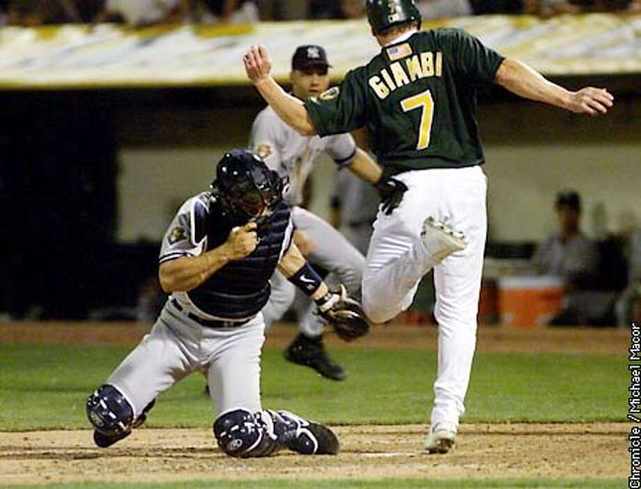 Oakland's Jason Giambi is tagged out by Yankees Jorge Posada in the 7th inning, GIambi tried to score on a Terrence long shot to right field. Oakland Athletics V. New York Yankees. Game 3 American League Championship series. by Michael MAcor/The Chronicle Photo: MICHAEL MACOR