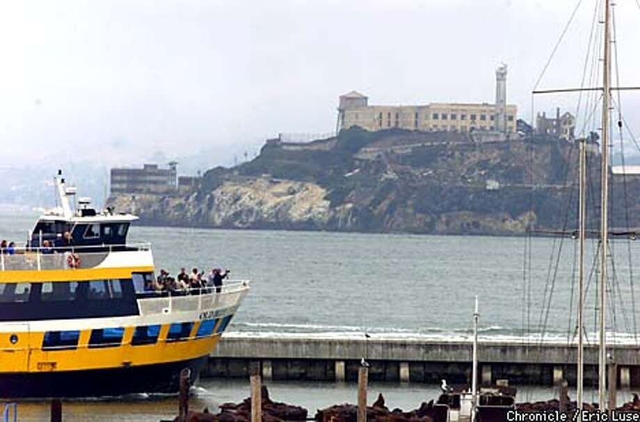 Tourist lon the Blue & Gold cruise past the Sea Lions at Pier 39 on their way out to Alcrataz.  BY ERIC LUSE/THE CHRONICLE Photo: ERIC LUSE