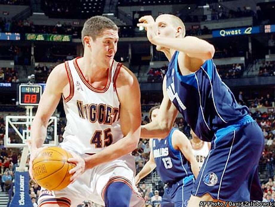 Denver Nuggets' Raef LaFrentz (45) tries to move against Dallas Mavericks forward Dirk Nowitzki in the first quarter in Denver on Thursday, Jan. 24, 2002. (AP Photo/David Zalubowski) Photo: DAVID ZALUBOWSKI