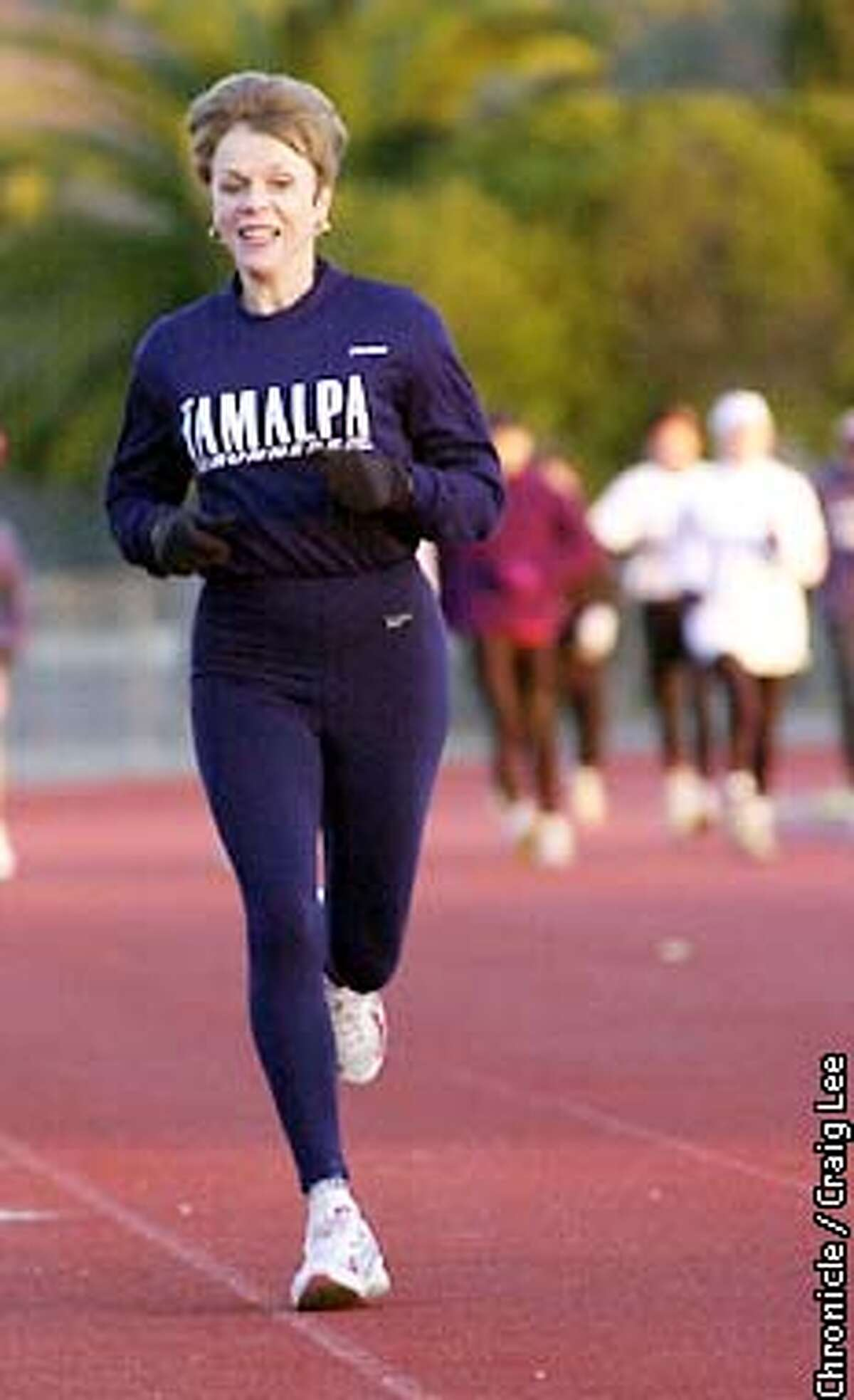 Shirley Matson didn't take up running until she was in her late 30's-early 40's, and now at age 61, she holds about every middle- to long-distance running record for women in age groups 50 and up. Photo of her on the track at the College of Marin. Photo by Craig Lee/San Francisco Chronicle